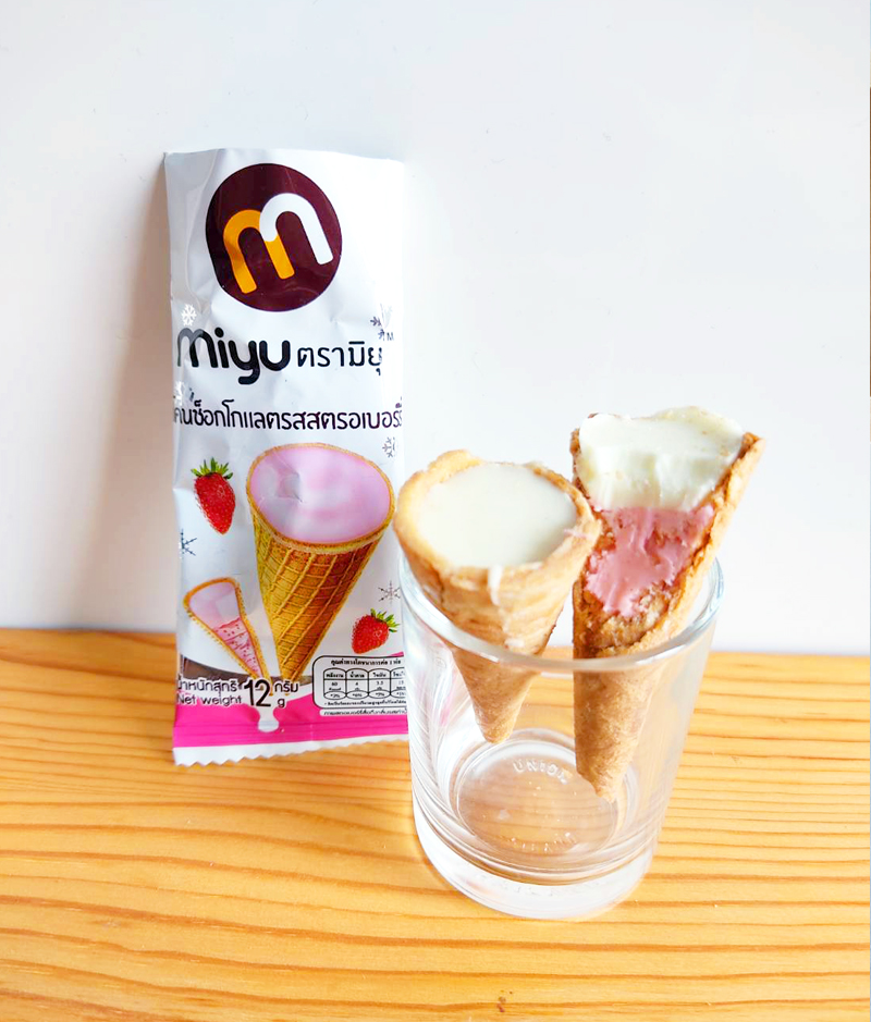 crispy cone with strawberry and milk filling